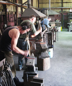 Blacksmiths working at the Australian Blacksmiths Association (Victoria) Bundoora workshop
